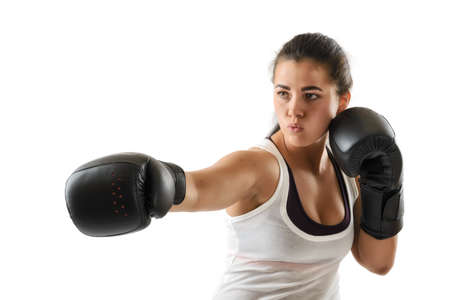 black gloves: Sporty muscular boxer woman during boxing exercise making direct hit in black gloves