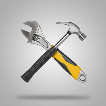 tooling: Crossed hammer and wrench. Tools for carpentry work.