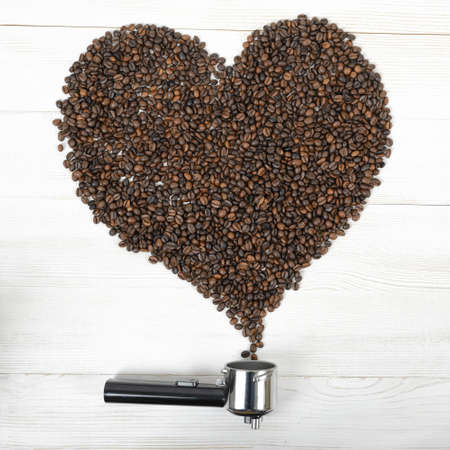 palatable: A portafilter handle and a heart shaped with arabica seeds.