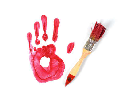 canvas print: A paint brush and gouache red hand print on white canvas background in top view. Stock Photo