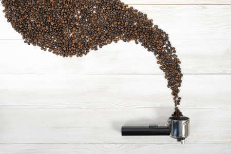 palatable: Horn-handle for coffee machine and shape with arabica seeds. Stock Photo
