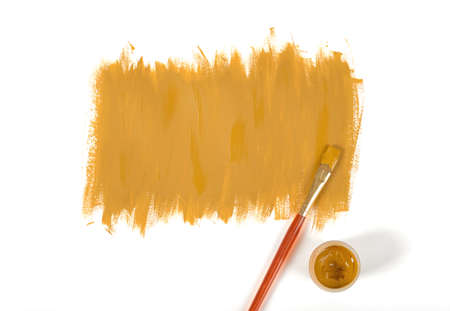 daub: Color of mustard gouache hand-painted daub with used paint brush and a gouache jar Stock Photo