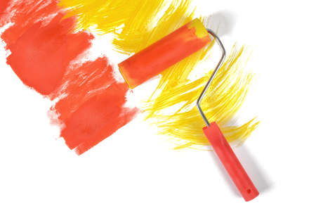 refit: Red-yellow traces of gouache painting by a roller on white background. Stock Photo