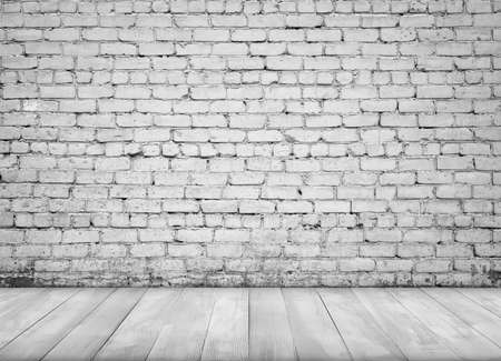 wood floor background: Interior with white brick wall and white wooden painted floor for background. Stock Photo
