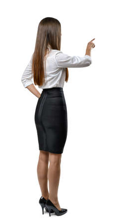 cognicion: negocios recorte en un vestido de la oficina imita el tacto de algo. El aprendizaje y la cognición. El éxito y el desarrollo. Equipo de negocios. ropa de oficina. Código de vestimenta. aspecto presentable. Belleza y la juventud. Foto de archivo