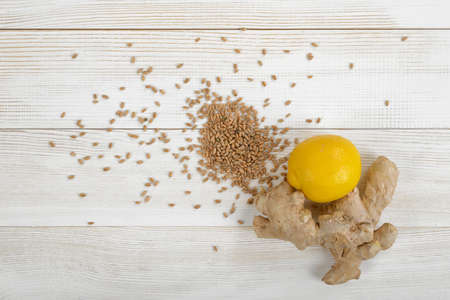 spreaded: Lemon and ginger with spreaded pearl barley in top view.  Food design. Ingredients to take for colds. Boosting immune system. Natural remedy. Weight loss. Helping prevent gallstones. Improves skin elasticity. Stock Photo
