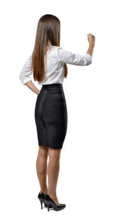 cognition: Cutout businesswoman in an office dress imitates the touch to something. Learning and cognition. Success and development. Business staff. Office clothes. Dress code. Presentable appearance. Beauty and youth.