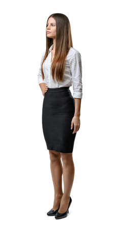 dress code: Cutout business woman stands sideway looking up. Success and development. Business staff. Office clothes. Dress code. Beauty and youth.