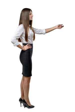 cognicion: negocios recorte en un vestido de la oficina imita el tacto de algo. El aprendizaje y la cognición. El éxito y el desarrollo. Equipo de negocios. ropa de oficina. Código de vestimenta. aspecto presentable. Belleza y la juventud. Perfil pose.