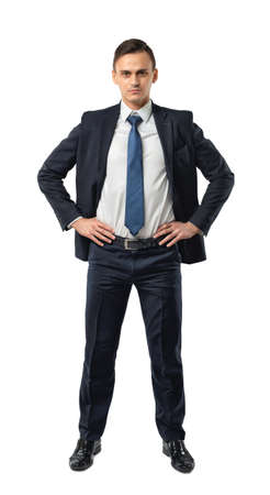 dress code: Cutout serious businessman holds his hands on his waist. Self-confidence. Strong commitment. Business staff. Office clothes. Dress code. Presentable appearance.