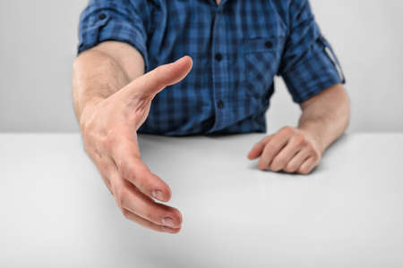 acquaintance: Close-up hand of man stretched out to greet. Greeting. Willingness to cooperate. Body language. Hand gesture. Acquaintance. Stock Photo
