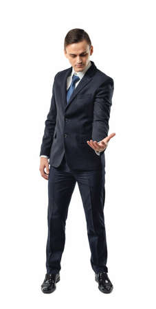 dress code: Businessman holding something in his palm and looking to it. Palm up. Successful lifestyle. Business staff. Office clothes. Dress code. Presentable appearance. Self-confidence.