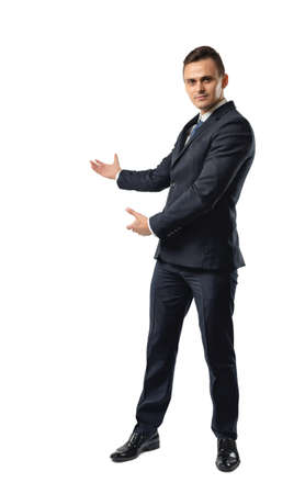 affability: Businessman stands showing the direction by both hands. Business staff. Office clothes. Dress code. Affability. Invite and guide. Stock Photo
