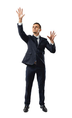 dress code: Businessman touching invisible wall. Front view. Obstacles and barriers. Office clothes. Dress code. Confusion and doubt. Search exit. Pantomime. Stock Photo