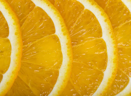 ageing: Close-up orange slices are in a row. Top view composition. Food decoration. Boosting immune system. Helps prevent ageing of skin. Protects your vision. Stock Photo
