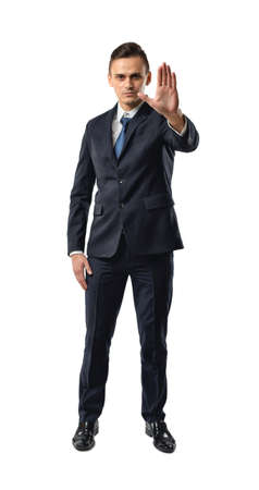 sarcastic: Cutout businessman showing stop hand sign. Talk to the hand. Sarcastic and obnoxious sign. Shut up. Business staff. Office clothes. Dress code. Presentable appearance. Stock Photo