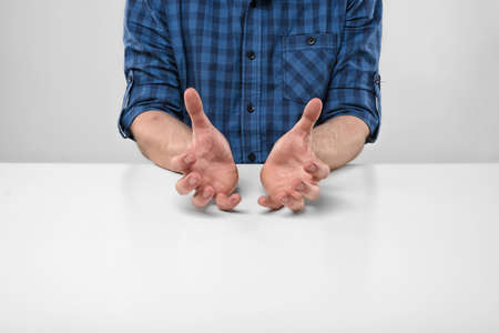 creative force: Cropped image of masculine hands showing the size of something. Hand gesture. Bad job. Symbols and gestures. Imitation. Stock Photo