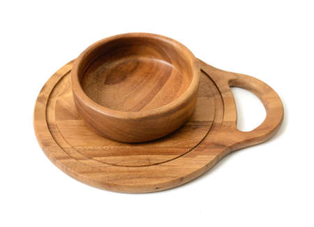 durable: Cutout wooden bowl on a wooden chopping board. Top view. Wooden Tableware. Environmentally friendly goods. Durable material. Naturally beautiful goods. Strength material. Safe to use.