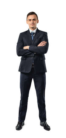 dress code: Businessman in an elegant  black suit stands with folded arms isolated on a white background. Cutout portrait. Business staff. Office clothes. Dress code. Presentable appearance. Successful lifestyle.