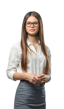 dress code: Cutout business woman looks directly at the camera. Smart staff. Success and development. Business staff. Office clothes. Dress code. Presentable appearance. Stock Photo
