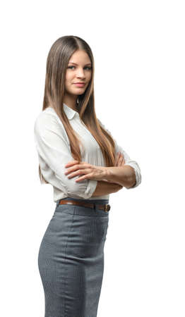 dress code: Cutout business woman with folded arms looks directly at the camera. Smart staff. Success and development. Business staff. Office clothes. Dress code. Presentable appearance.