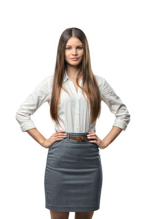 dress code: Business woman puts her hands on waist, isolated on white background. Smart staff. Success and development. Business staff. Office clothes. Dress code. Presentable appearance.