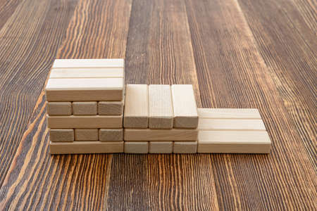 mental activity: Close-up wooden bricks in the form of steps. Game of physical and mental skill. Entertainment activity. Education and development. Side view. Stock Photo