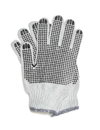 elementos de protección personal: Cut-out par de guantes de punto blanco con el lado cubierto de caucho. Guantes protectores para trabajar con las manos. Cubierta y protección para las manos. Jardinería. Tipo de ropa. Cerca de la foto