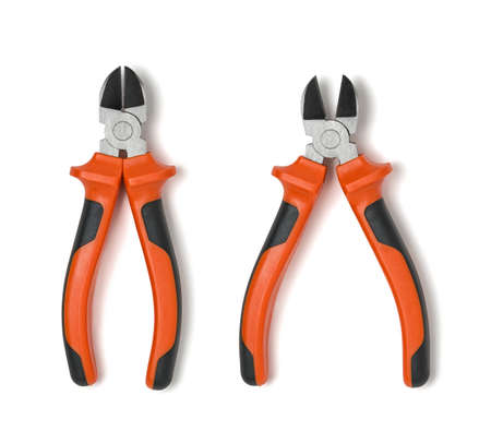 implements: Cut-out open and closed pliers. Close-up photo. Everyday instruments and tools. Construction and Repair. Mend and repair. Building and construction. Building implements. Tool.