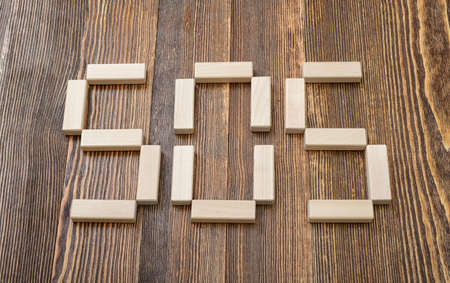 mental activity: Close-up wooden bricks making form of words SOS. Top view. Concept. Close-up photo. Game of physical and mental skill. Keeping balance. Entertainment activity. Education and development. Stock Photo