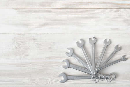 mend: Different sized wrenches spread out like a fan. Top view composition. Hexagonal shape. Hand tool. Tools for carpentry work. Type of fastener. Mend and repair. Parts for repair. Stock Photo
