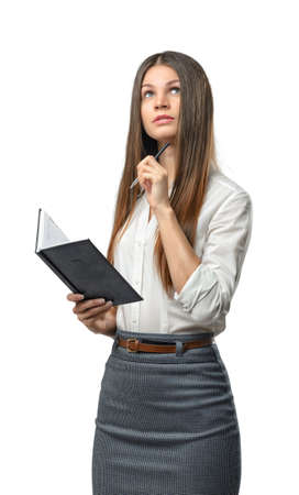 businesswoman suit: Cutout business woman holding a book and looking away. Smart staff. Success and development. Business staff. Office clothes. Learning and teaching. Study process. Stock Photo