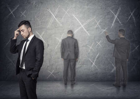 x marks: Image of a businessman thinking about how to solve a problem with x marks around him. Stock Photo