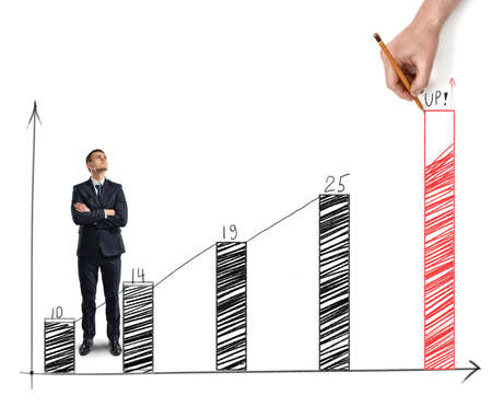 viability: Businessman standing alongside a sketched increasing bar graph with a hand drawing the final bar in red showing the target and the necessary improvement required to meet the goal