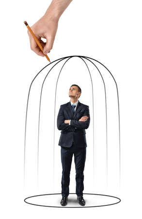 restrain: Businessman with his arms folded standing in a hand drawn cage isolated on white background. Business staff. Despair and misfortune. Office clothes. Helpless situation. Stock Photo