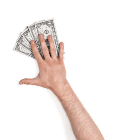 Close up view of a mans hand lying on dollar bills, isolated on white background. Stock Photo