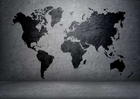 gray: Black-colored world map on concrete wall.