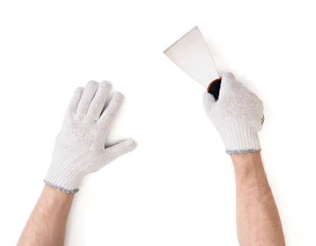 Close-up view of mans hands in white cotton gloves with a putty knife isolated on white background.