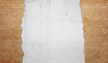 plasterwork: Yellow brickwork underneath concrete wall.