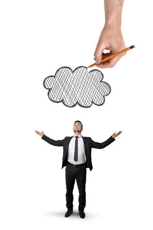 incertitude: Back view of a businessman stands with raised hands and big hand above that draws a cloud isolated on white background.
