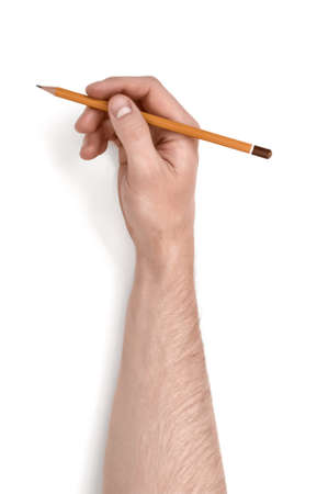 Close up view of a mans hand holding a pencil isolated on white background. Stock Photo