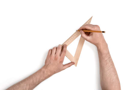 draftsman: Close-up hands of man while working process with triangle centimeter ruler. Top view composition. Work place of draftsman, architect, constructor. Stock Photo