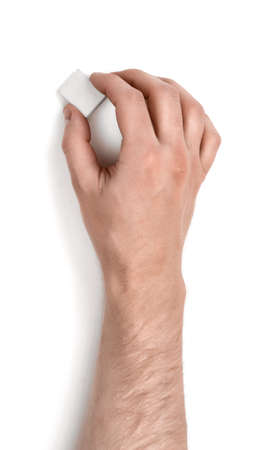 hand rubbing: Close up view of a mans hand holding an eraser isolated on white background. Erasing and rubbing off. Drafting equipment. Art and inspiration.