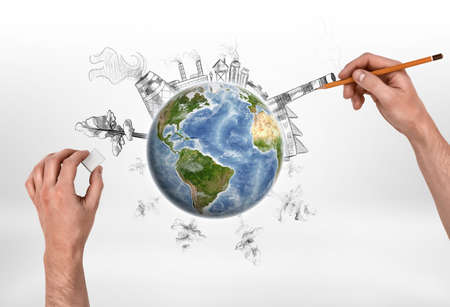 emissions: Hands of man drawing a factory and erasing trees on the globe. Deforestation. Depletion of natural resources. Urbanization. Harmful emissions. Elements of this image are furnished by NASA