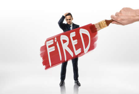 expel: Hand drawing red line with sign fired over the businessman. Losing a job. Jobless. Discharging. Unemployment.