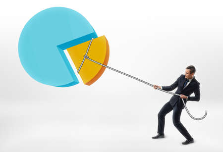 outgoings: Businessman pulling a rope with a piece of the pie chart. Reduction in costs and outgoings. Hard work. Focus on results. Stock Photo