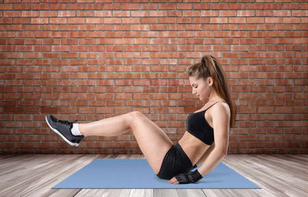 active wear: Fitness girl wearing an active wear and doing her exercise on a yoga mat. Yoga and fitness. Enjoying sport. Healthy lifestyle. Stock Photo