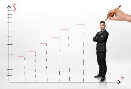 improving: Smiled businessman standing on a schedule of profit growth and someone hand drawing a red line above his head. Increasing income. Revenue and profits. Career progress. Improving success rate.