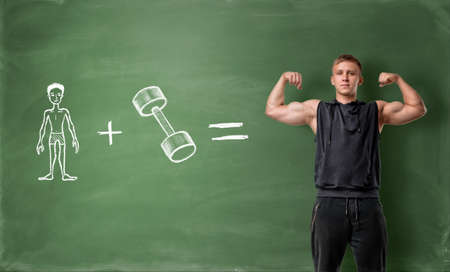 Skinny hand drawn man plus dumbbell equals handsome muscled man on green chalkboard background. Bodybuilding and powerlifting. Professional athlete. Will power and volition.