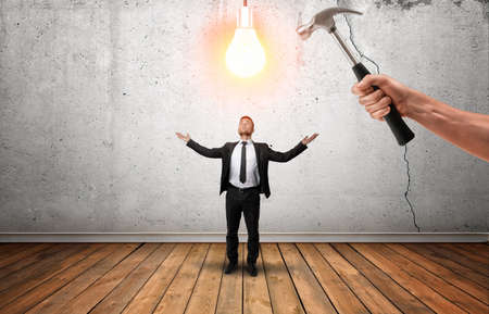 punishable: Hand holding a hammer going to break glowing bulb over businessmans head. Initiative is punishable. Killing potential. Limit the idea.